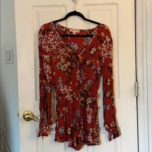 Romper with bell sleeves and pockets!